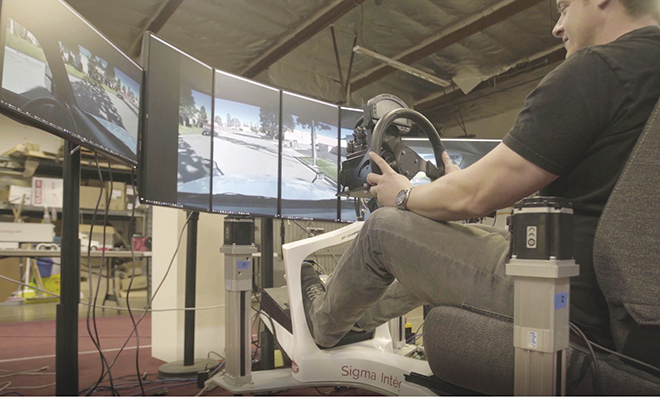 A driver controls a truck remotely