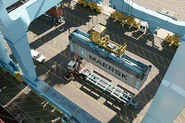 A crane lowers a Maersk shipping container at the Port of Los Angeles.