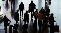 Travelers walk through the Salt Lake City International Airport on Nov. 25. (Rick Bowmer/Associated Press)