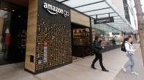 Customers exit an Amazon Go store in Seattle