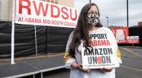 An RWDSU supporter holds a sign outside of union headquarters in Birmingham, Ala.
