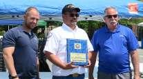 Walmart's Robert Benton (center) wins Delaware's Grand Champion honors for 2019