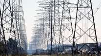 Power lines are seen in Houston in February. (David J. Phillip/Associated Press)