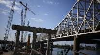 Construction crews work to erect a highway bridge in Kentucky in 2014. (Luke Sharrett/Bloomberg News)
