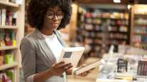 A shopper browses books at a bookstore