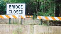 A sign indicating a bridge is closed