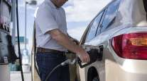 california driver pumping gas