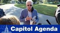 President Joe Biden huddles with reporters