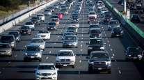 Traffic travels eastbound on Interstate 80 in Berkeley, Calif.
