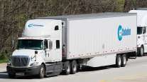 Celadon truck on highway