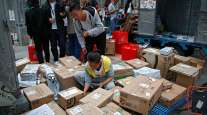 Delivery workers sort boxes in Beijing