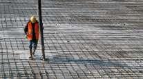 Construction worker pours concrete
