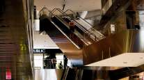 A shopper rides an escalator at the Hudson Yards mall in New York.