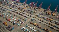 Gantry cranes sit idle at a container terminal in Long Beach, Calif. (Tim Rue/Bloomberg News)