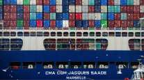 Shipping containers sit aboard the CMA CGM SA Jacques Saade LNG container ship. (Nathan Lane/Bloomberg News)