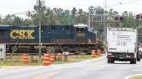 A CSX train crosses an intersection in Ocala, Fla. (Doug Engle/Ocala Star Banner)
