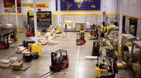 Forklifts move cargo at a DHL Worldwide Express hub