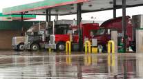 Trucks getting diesel at a station