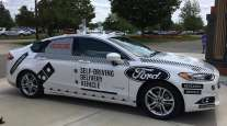 The specially designed delivery car that Ford Motor Co. and Domino's Pizza will use to test self-driving pizza deliveries, at Domino's headquarters in Ann Arbor, Mich.