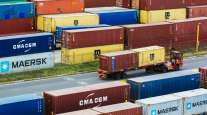 A truck transport shipping containers at the Port of Durban. (Waldo Swiegers/Bloomberg News)