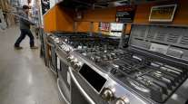 Stoves sit on a display at a Home Depot location in Boston. (Steven Senne/Associated Press)