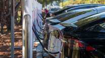 Tesla vehicles charge at a station in San Mateo, Calif., on Sept. 22.