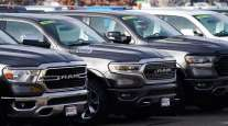 A row of unsold 2020 pickup trucks sits at a Ram dealership in Colorado in December 2020. (David Zalubowski/Associated Press)