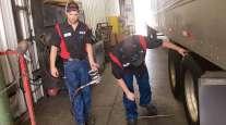 CFI technicians inspect a truck's tires