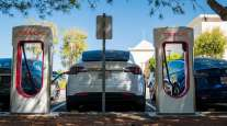 A Tesla vehicle charges at a charging station in San Mateo, Calif., in September 2020. (David Paul Morris/Bloomberg News)