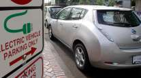 A Nissan Leaf charges in Portland, Ore.