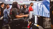 Students using simulator