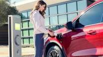 Woman fuels Ford hybrid