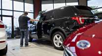 A customer looks over a Ford 2020 Explorer