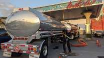 Trucker filling up with gasoline
