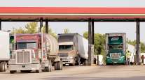 Trucks fueling at a station