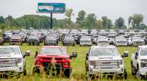 Chevrolet Silverados and GMC Sierra pickups built at Flint Assembly are parked