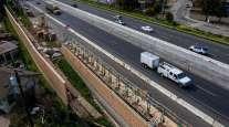 Contractors work on a portion of Highway 101 in Petaluma, Calif.