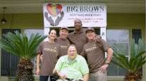 James Joseph and helpers from UPS pose with Desi Kent