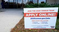 A sign is seen outside an employment center in Arlington Heights, Ill., on Nov. 5.