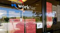 Information signs are displayed at a closed Illinois work center on June 11.