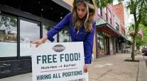 woman with employment sign