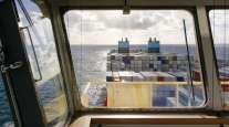 Shipping containers sit aboard a Maersk container ship. (Kristian Helgesen/Bloomberg News)