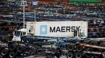 A Maersk truck transports a shipping container