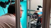 OpenAI researcher Jonas Schneider examines the research lab's robotic hand