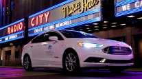 Mobileye's autonomous vehicle passes a New York City landmark, Radio City Music Hall