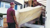 Movers loading a van