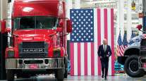 President Biden moves toward the podium to speak at the Mack Trucks plant in Macungie, Pa.