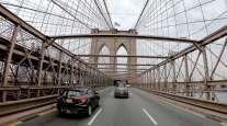 Traffic crosses the Brooklyn Bridge into Manhattan