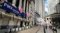 Pedestrians pass the New York Stock Exchange Oct. 2, in New York.