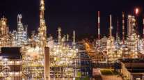 Pipework and towers at an oil refinery in Poland.